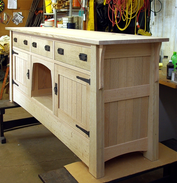 When the piece was in the white wood stage we let it set for Custom fish tank stand